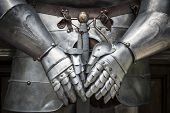 stock photo of soldier  - Detail of a knight armor with sword - JPG
