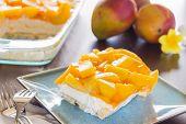 stock photo of jello  - Decadent cheesecake topped with fresh mango and orange jello with macadamia nut crust - JPG