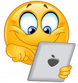 stock photo of emoticon  - Emoticon using a tablet pc - JPG