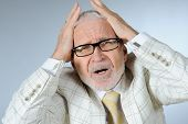 picture of angry man  - Portrait of a stressed senior businessman  - JPG