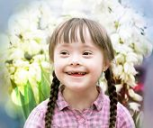 image of playgroup  - Portrait of beautiful young girl on flowers background - JPG