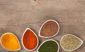 picture of flax seed  - Colourful ground or dried herbs and spices with copy space above - JPG