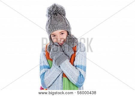 Beautiful little girl in cap and scarf
