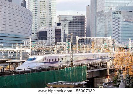 TOKYO- DEC 12, 2013: Shinkansen bullet train depart from Tokyo railway station in Dec 12, 2013 Tokyo, Japan. Shinkansen is world's busiest high-speed railway operated by four Japan Railways companies.