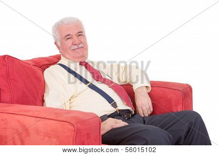 Senior Gentleman Relaxing In An Armchair