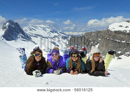 Young Girls Are Snowboarders In Mountains