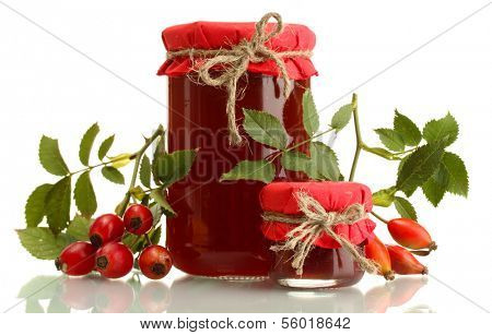 jars with hip roses jam and ripe berries, isolated on white