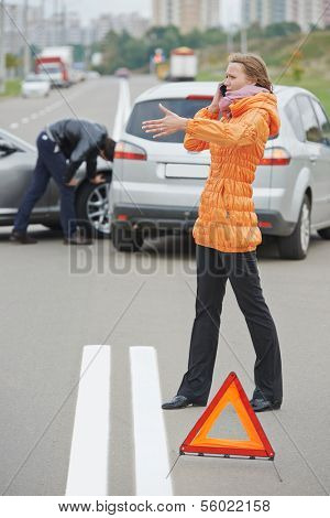 Car collision. driver man and woman examining damaged automobile cars after crash accident in city