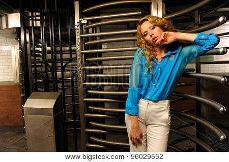 Glamor model posing by entrance with revolving door