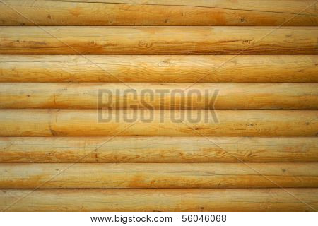 Close up shot of parallel wooden logs background