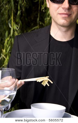Eating With Chop Sticks