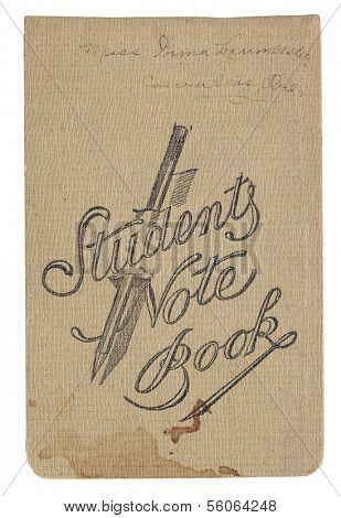 Vintage student notebook with stains, handwriting, fabric, with clipping path