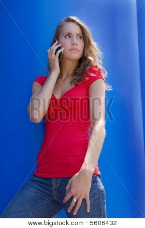 Pretty brunette student with cell phone
