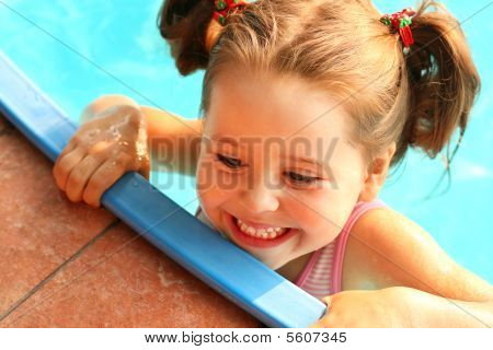 Cute Girl In The Swimming Pool