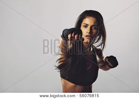 Female Boxer Throwing A Punch In Front