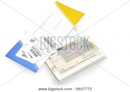 Passport And Air Ticket With Baggage Check Isolated Over White.