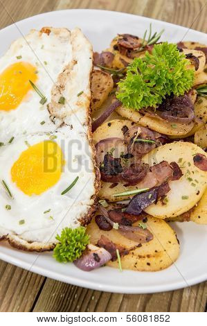 Fried Egg On A Heap Of Roasted Potatoes