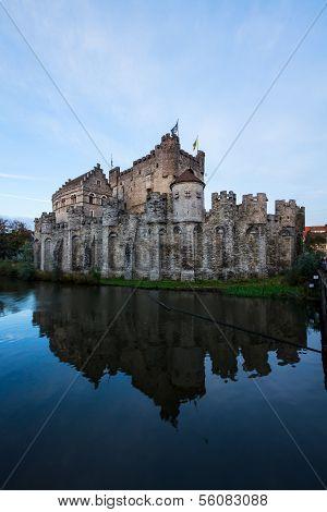 Gravensteen castle over pond, Ghent