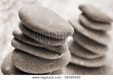 some stacks of balanced stones on an old wooden surface