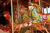 foto of merry-go-round  - colourful horses on a merry go round - JPG