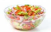 A big bowl with fresh summer salad, closeup shoot, isolated over white
