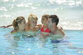 stock photo of infinity pool  - Happy family enjoying bath time in infinity pool - JPG