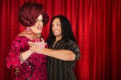 foto of cross-dressing  - Happy cross dressing man dancing with smiling boyfriend - JPG
