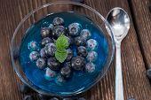 stock photo of jello  - Portion of Blueberry Jello on wooden background - JPG