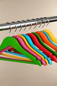Colorful clothes hangers on gray background