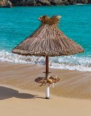 Umbrella on the beach of Paeokastritsa in Corfu Greece