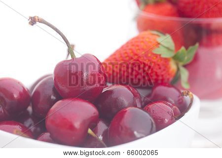Cherries And Strawberry In A Bowl Isolated On White