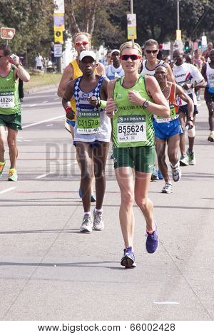 Woman In Green Running The Comrades Marathon