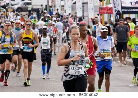 Determined Female Runner In Comrades Ultra Marathon