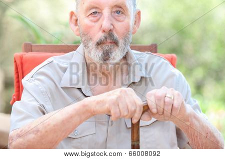 healthy senior in care home, old man with walking stick