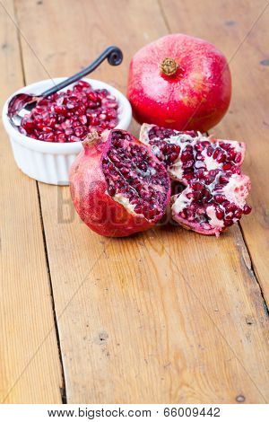 Fresh Pomegranate Fruit And Pips In White Bowl