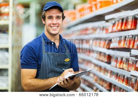 hardware shop storekeeper counting stock