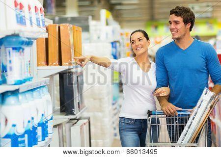 smiling couple shopping at hypermarket