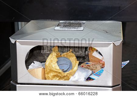 Trash can full of fast food packaging.