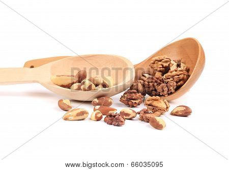 wood spoons with walnuts and brazil nuts