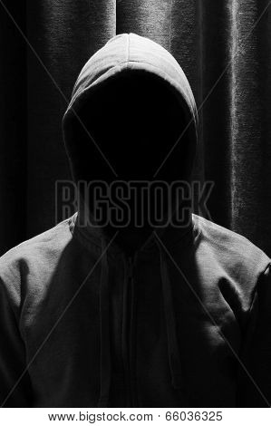 Portrait Of Invisible Man In The Hood With Curtain Background
