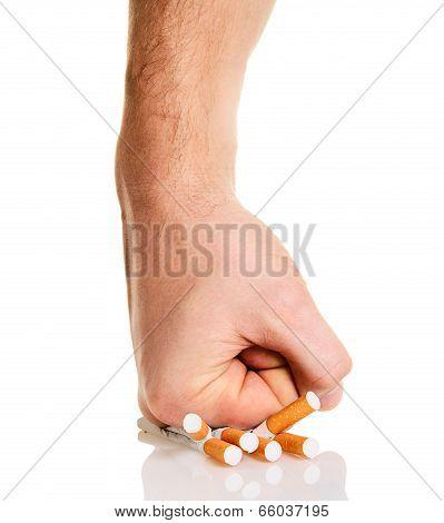 Man's Fist Crushing Cigarettes