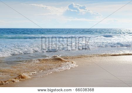 Seascape, Sand Beach And Blue Sky