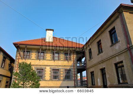 An Old European Mediterranian Style House Against Blue Sky.