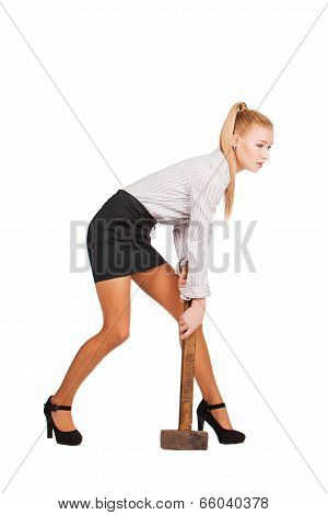 Young attractive businesswoman with hammer