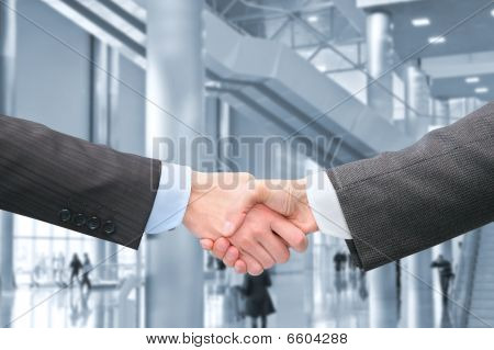 Shaking Hands With Wrists In Hall Of Business Center Collage