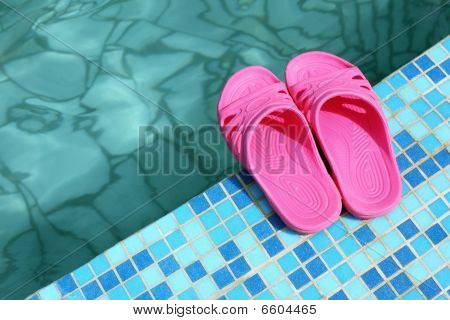 Beach Slippers On Pool Side