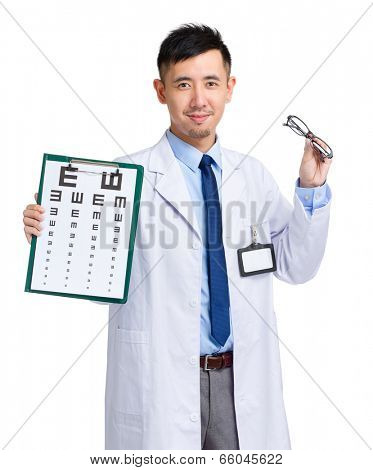 Asian oculist holding eye chart and glasses