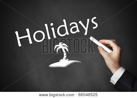 hand writing holidays on chalkboard