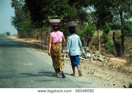 Burmese Woman Carrying On Their Heads.