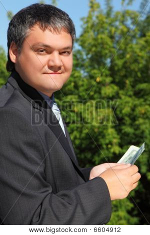 Businessman Counting Money Outdoor In Summer